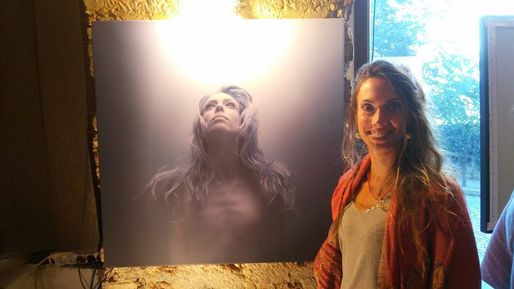 Model beside her picture